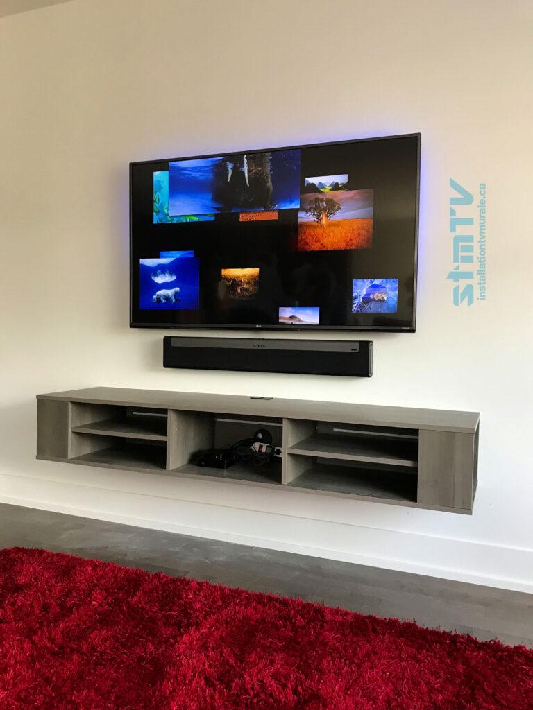 meuble télé sur le mur avec barre de son et cables dissimulé