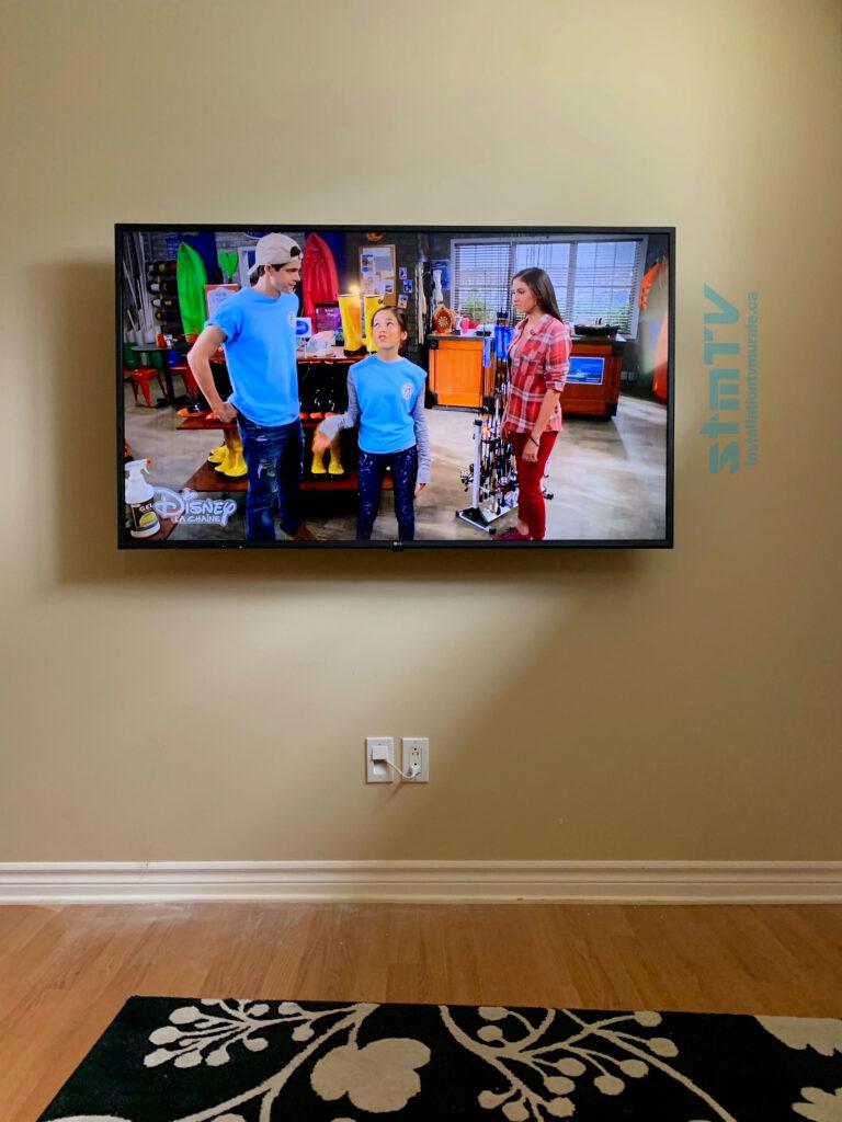 tv au mur cables dissimulé