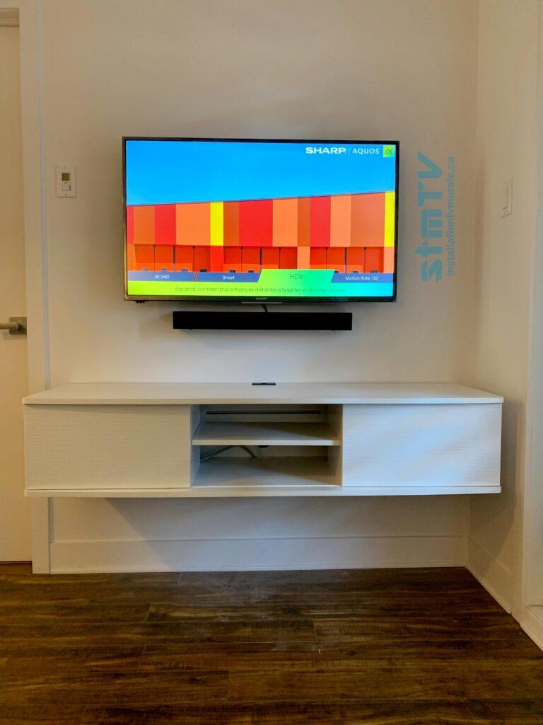 installateur pour fixer support tv au mur
