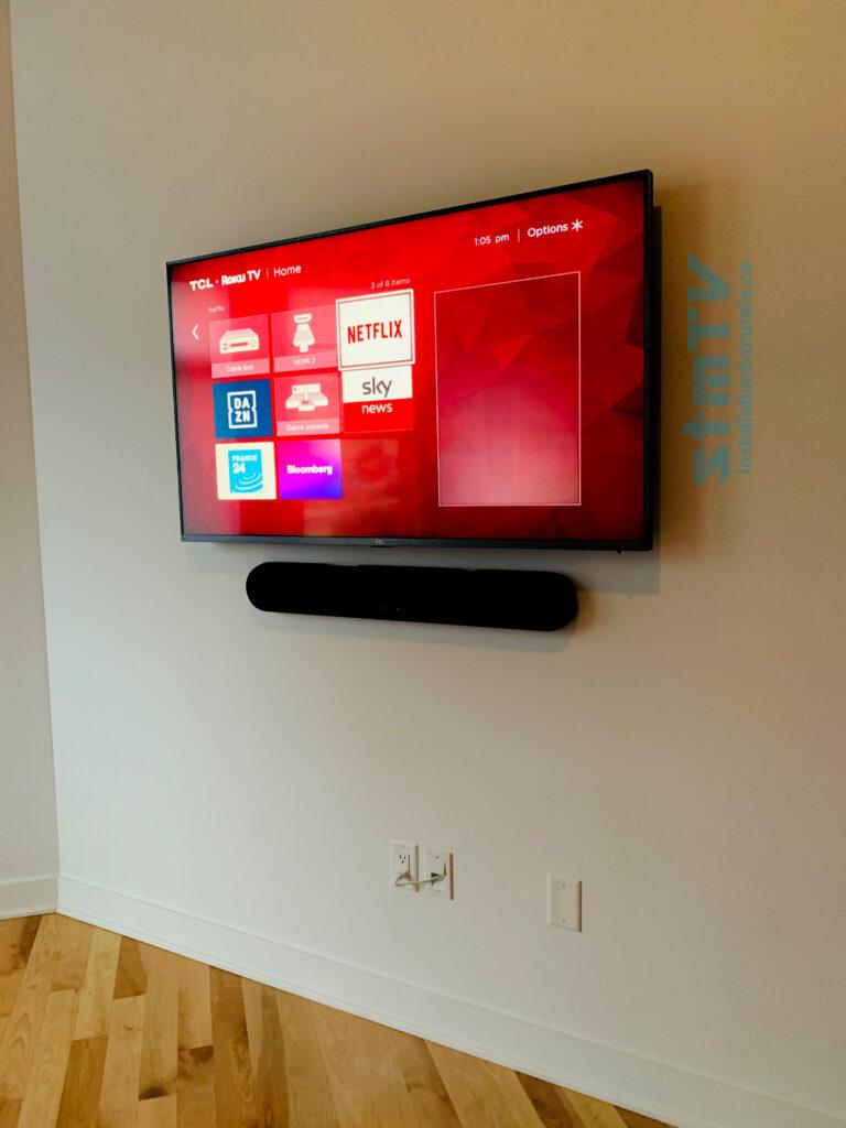 tv au mur barre de son murale cables dissimulé
